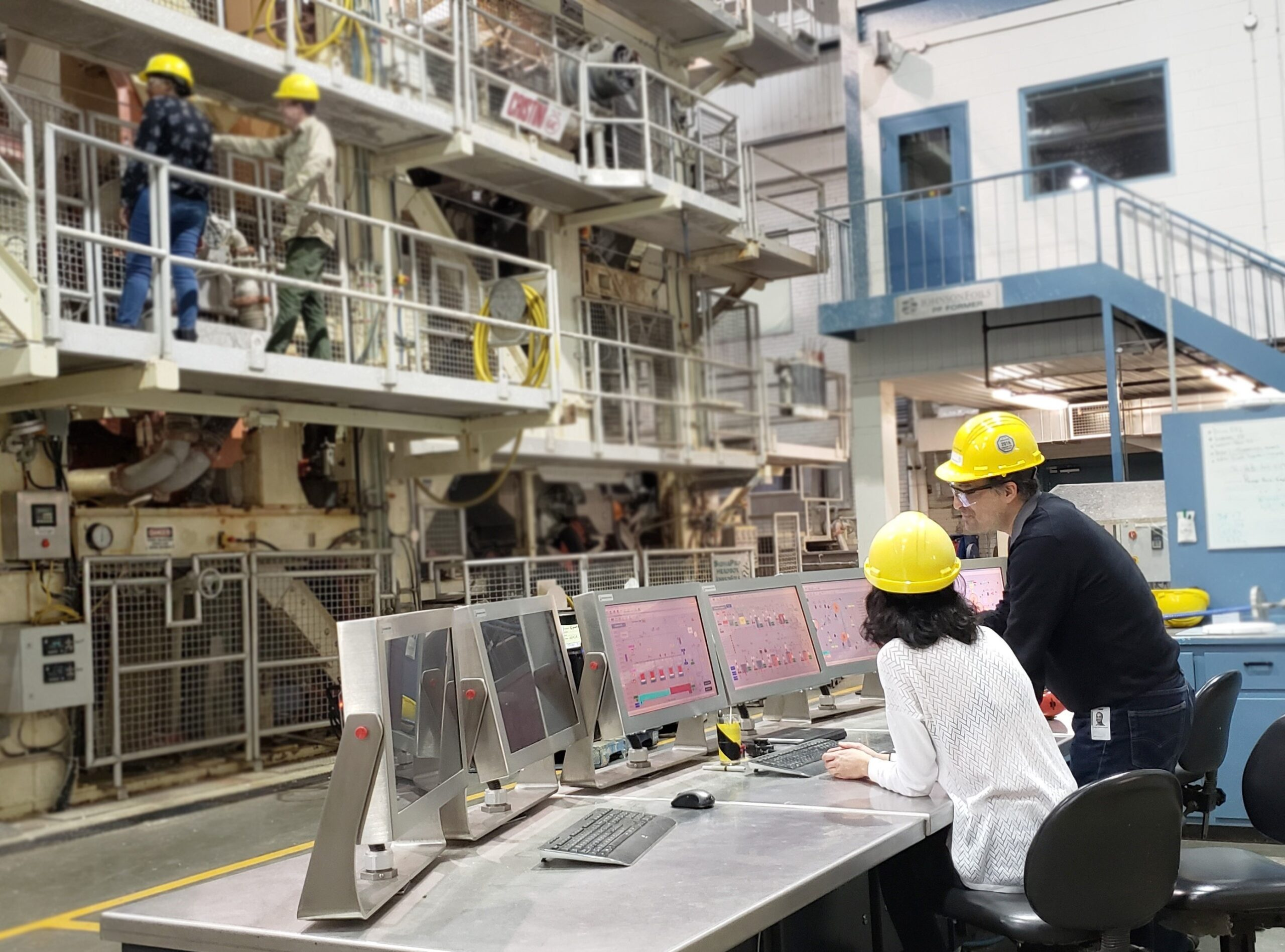 Scientists in FPInnovations pilot-scale paper-machine facility