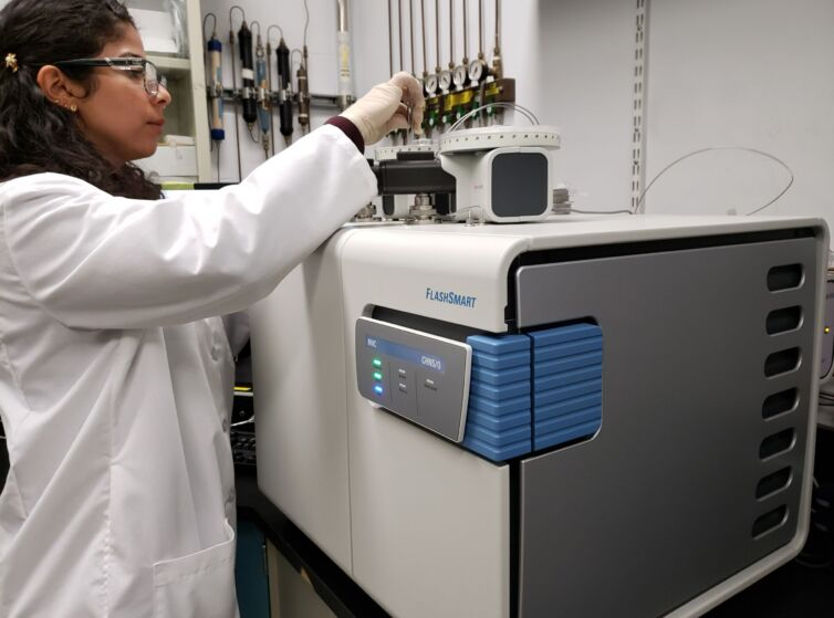 Lab technician placing sample on the elemental analyzer